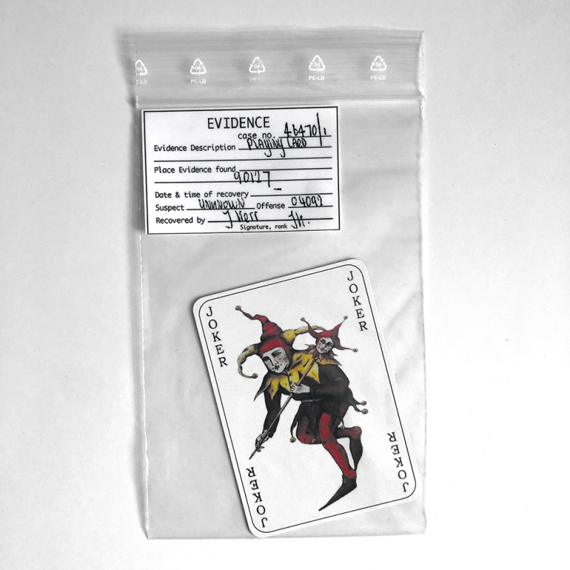 Joker calling card in evidence bag from BATMAN BEGINS