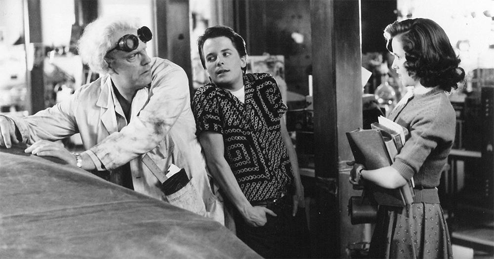 Michael J. Fox and Christopher Lloyd with Lea Thompson.