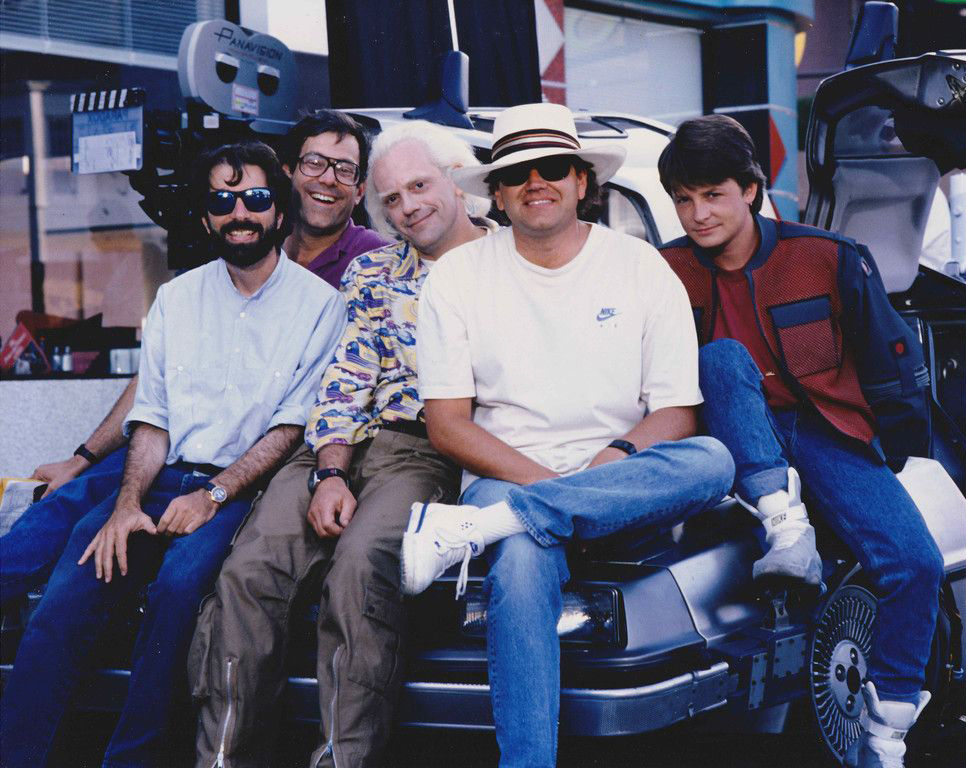 Robert Zemeckis, Bob Gale and Neil Canton with Michael J. Fox and Christopher Lloyd.