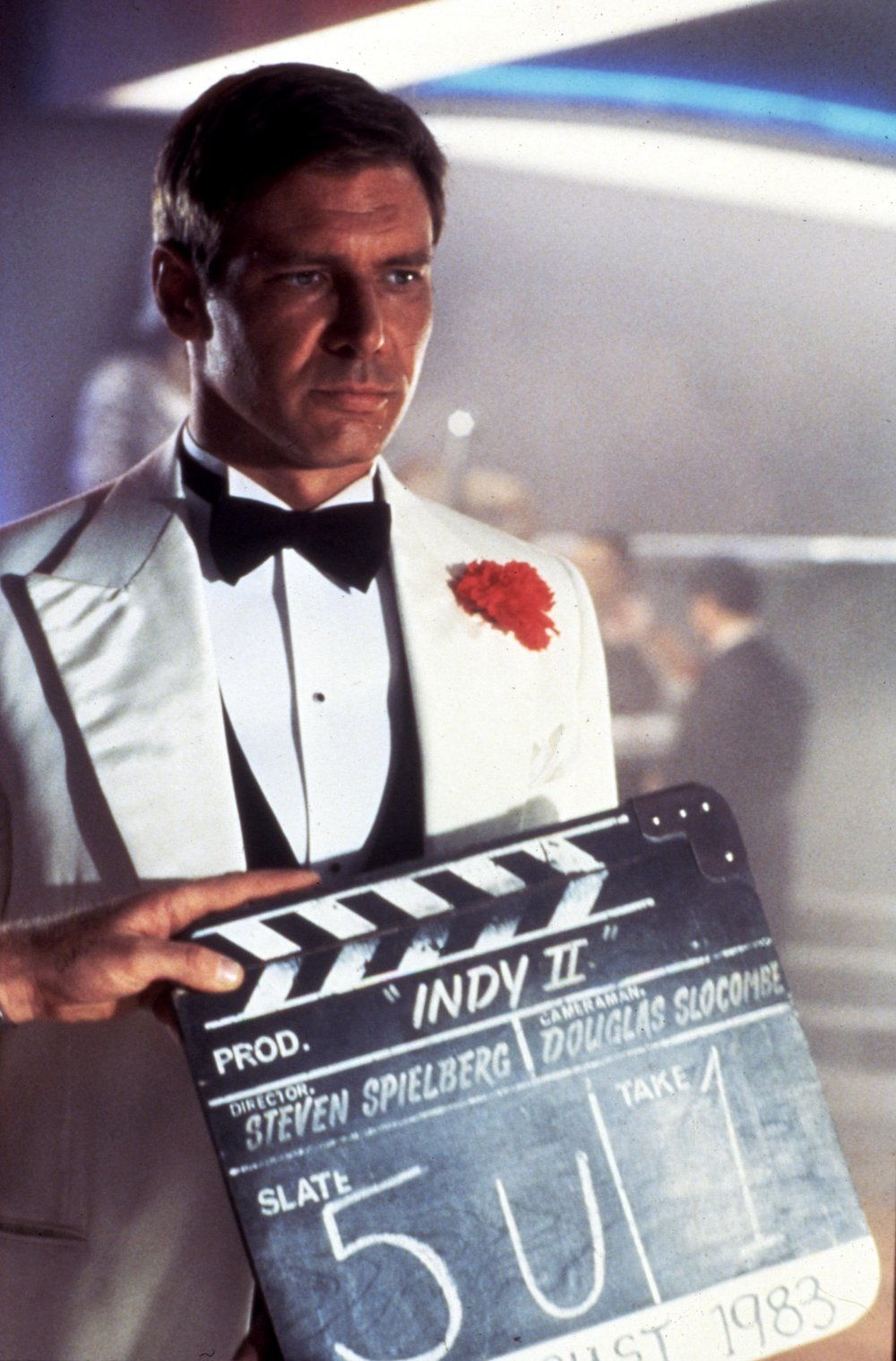 Harrison Ford shooting the opening sequence of The Temple of Doom