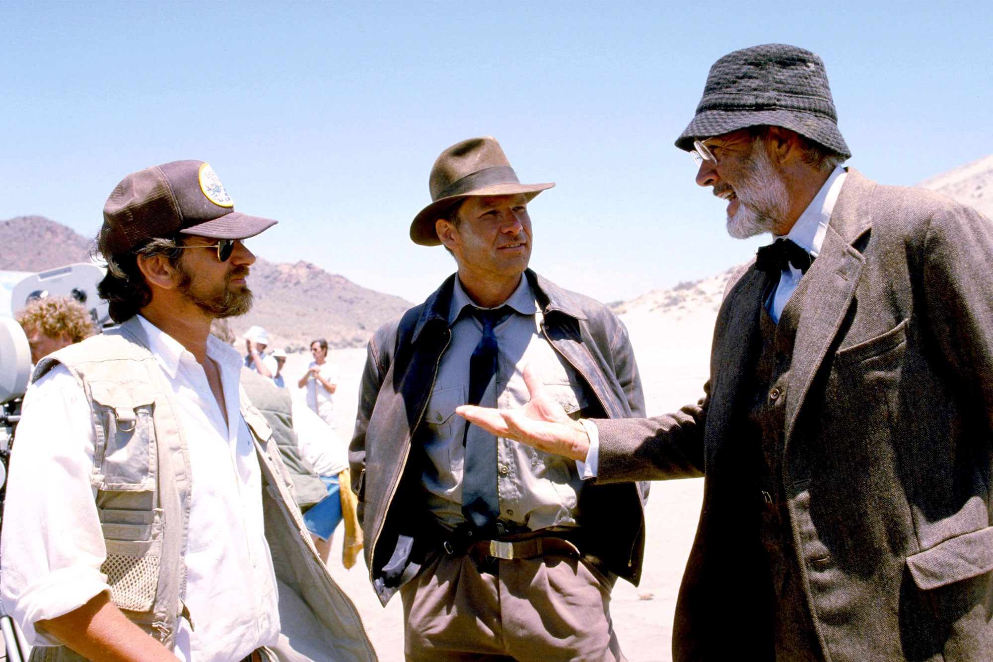 Harrison Ford and Sean Connery discuss last details with Steven Spielberg.