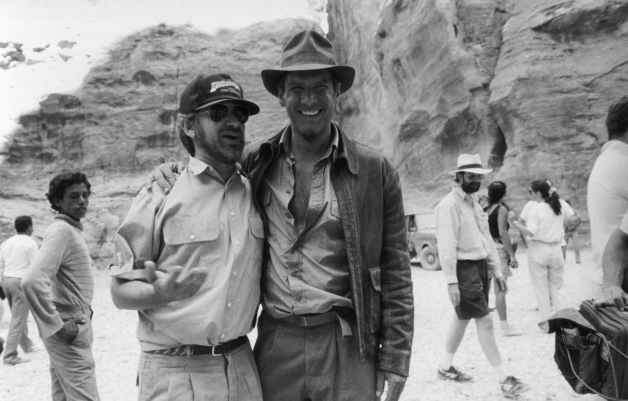Harrison Ford with Steven Spielberg on the set of Indiana Jones and the Last Crusade.