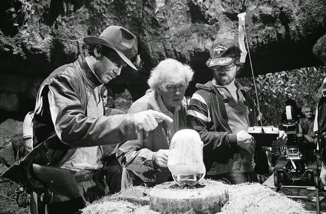 Harrison Ford and Steven Spielberg discussing the opening scene from Raiders of the Lost Ark.